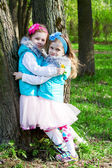Two little girls in park in the spring — Stock Photo