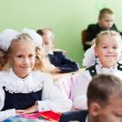 Stock Photo: Two girls in the classroom on the first lesson of the first of S