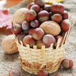 Various nuts in a wicker basket — Stock Photo