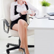 Young woman on a workplace at office — Stock Photo