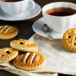 Cups of tea and biscuits  — Stock Photo