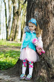 Little girl in park in the spring — Stock Photo