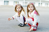 Two little sisters in port — Stock Photo