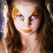 Pretty girl with face painting on black background — Foto de Stock
