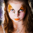 Pretty girl with face painting on black background — Stock fotografie