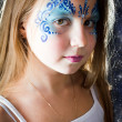 Pretty girl with face painting on black background  — Stock Photo