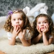Two sisters with angel wings — Stock Photo