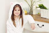 Girl in a bathrobe — Stock Photo