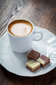Cup of coffee and chocolate — Stock Photo