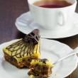 A slice of cake with a cup of tea — Stock Photo