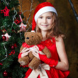 Cute little girl near a Christmas tree — Foto Stock