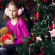 Cute little girl in Christmas decorations — Stock Photo