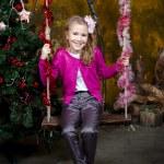Little girl sitting on the swing — Stock Photo #33599979