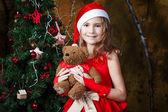 Cute little girl near a Christmas tree — Stock Photo