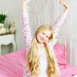 Young girl wakes up in the morning — Stock Photo #34158415