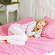 Little girl sleeping in bed — Stock Photo
