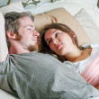 Young man and woman in bed. — Stock Photo