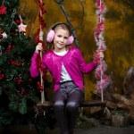 Happy little girl sitting on the swing — Stock Photo #35840459