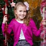 Happy little girl sitting on the swing — Stock Photo #35840461