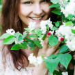 Young woman in a blossoming garden  — Stock Photo