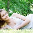 Beautiful girl lying on the grass  — Stock Photo