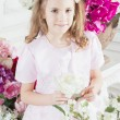 Portrait of little cute girl with flowers — Stock Photo #45524685