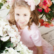 Portrait of little cute girl with flowers — Stock Photo #45524691