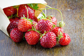 Fresh strawberries in a paper bag  — Stock Photo
