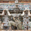 Giant Statue on wall in temple of thailand — Stock Photo