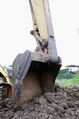 Excavator digging a deep trench — Stock Photo