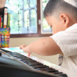 Little Boy playing piano fun — Stock Photo