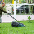 Man cutting grass. With the mower. — Stock Photo