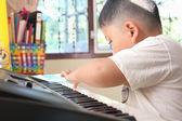 Little Boy playing piano fun — Stock Photo