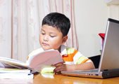 Asian boy work homework carefully. — Stock Photo