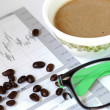 Coffee cup on office documents — Stock Photo