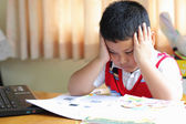 The boy work homework carefully. — 图库照片