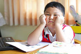 The boy tired of homework. — Stock Photo