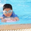 The boy was swimming in the pool. — Stock Photo