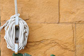 Nylon rope tied to the wall — Stock Photo