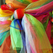 Stock Photo: Colorful fabric tied to tree