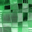 Stock Photo: Stained glass window with irregular block pattern in hue of gr