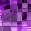 Stock Photo: Stained glass window with irregular block pattern in hue of Pu