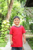 Portrait of cute asian boy smiling in the park — Stock Photo