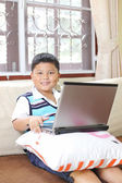 Asian boy playing notebook for learning — Stockfoto