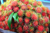 Rambutan (tropical fruit) on sales in the market — Stock Photo