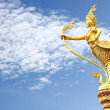 Gold Garuda statue in the sky — Stock Photo