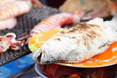 Grilled fish on the stove — Stock Photo