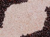 Coffee beans on the yarn — Stock Photo