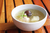 Chicken soup on a wooden table — Stock Photo