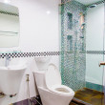 Bathtub and toilet in modern bathroom — Stock Photo